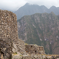 """According to """"Wikipedia"""" - The Incas never used the wheel in any practical manner. Its use in toys demonstrates that the principle was well-known to them, although it was not applied in their engineering. The lack of strong draft animals, as well as steep terrain and dense vegetation issues, may have rendered the wheel impractical. How they moved and placed the enormous blocks of stones remains a mystery, although the general belief is that they used hundreds of men to push the stones up inclined planes. A few of the stones still have knobs on them that could have been used to lever them into position; it is believed that after the stones were placed, the Incas would have sanded the knobs away, but a few were overlooked."""