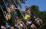Brothers Levi, 6, and Bode Kaeser, 8, reach out to each other as they ride the Flying Circus swings at the Williamson County Fair on Saturday. The fair continues through August 12th at the Williamson County Agricultural EXPO Park in Franklin.