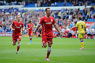 Anthony Pilkington of Cardiff city © celebrates after he scores his sides 2nd goal. Skybet football league championship match, Cardiff city v Sheffield Wed at the Cardiff city stadium in Cardiff, South Wales on Saturday 27th Sept 2014<br /> pic by Andrew Orchard, Andrew Orchard sports photography.