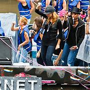 NLD/Amsterdam/20100807 - Boten tijdens de Canal Parade 2010 door de Amsterdamse grachten. De jaarlijkse boottocht sluit traditiegetrouw de Gay Pride af. Thema van de botenparade was dit jaar Celebrate, Froukje de Both