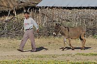 Farmer with donkey. Lake Prespa National Park, Albania June 2009