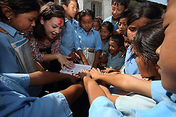 Louisa Zhang Research and Documentation Support Office works with children at a <br />Nepal Water for Health (NEWAH) WASH water project in Puware Shikhar, Udayapur District, Nepal.