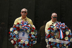 May 27, 2019 - Washington, District of Columbia, United States - Wreath laying ceremony participants listen as the honor guard plays taps after wreaths are laid in honor of those who died during the Vietnam War, at the Vietnam Wall on Memorial Day in Washington DC. (Credit Image: © Jeremy Hogan/SOPA Images via ZUMA Wire)