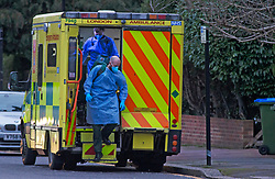 © Licensed to London News Pictures 21/01/2021.        Greenwich, UK. Two London Ambulance service paramedics are dressed in full PPE before entering a residential property in Greenwich, South East London during a third Coronavirus Lockdown. Photo credit:Grant Falvey/LNP