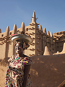 A woman selling jewellery outside the Great Mosque of Djenné, the worlds largest mud built structure and UNESCO heritage site, at Djenné, Mali