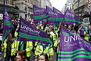 Peaceful demonstration along Piccadilly in central London by protesters during the TUC union march against cuts, Saturday March 26th 2011. Around 400,000 people joined the TUC's March for the Alternative to oppose the coalition government's spending cuts. Teachers, nurses, midwives, NHS, council and other public sector workers were joined by students and pensioners to bring the centre of the capital to a standstill and to make their point that the current coalition government is making cuts too fast which they suggest will have a catastrophic effect on jobs and economic recovery.
