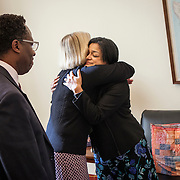 Representative Pramila Jayapal (D-WA, 7), right, finishes her first constituent meeting of the day, speaking to Mary Fertakis and Stephen Blanford, a Seattle School Board Director, of the Washington State School Directors Association, on Tuesday, January 31, 2017.  Among other topics of concern, they discussed the potential ramifications of President Trump's immigration and border security policies. For The Stranger (Seattle, WA).