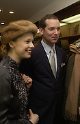Katrin Buchanan and Adam Buchanan. Charles Finch and Dr. Franco Beretta host launch of Beretta stor at 36 St. James St. London. 10  January 2006. ONE TIME USE ONLY - DO NOT ARCHIVE  © Copyright Photograph by Dafydd Jones 66 Stockwell Park Rd. London SW9 0DA Tel 020 7733 0108 www.dafjones.com