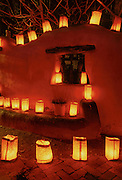 Luminarias on wall, Christmas Eve, Old Town Albuquerque, New Mexico