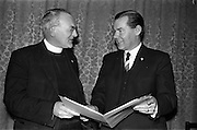 22/03/1963<br /> 03/22/1963<br /> 22 March 1963<br /> New Committee of the Kerrymans Association in Dublin. The committee for 1963 was elected at the Annual General Meeting of the Kerrymans Association at Jury's Hotel, Dublin. Picture shows the President of the association, Rev. Fr. M. Heffernan, O.S.A. (Castleisland), St. John's Augustinian Priory, Dublin chatting to the Chairman, Mr p.J. Moriarty (Dingle).