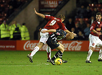 Photo: Dave Linney.<br />Walsall v Notts County. Coca Cola League 2. 25/11/2006.<br />Walsall's Martin Butler (L) battles with Andy Parkinson.