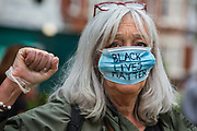 People joining a Black Lives Matter demonstration and 8 minute vigil on 3rd June 2020 in Crouch End, London, United Kingdom.  The death of an African-American man, George Floyd, at the hands of police in Minneapolis has sparked violent protests across the USA. A video of the incident, taken by a bystander and posted on social media, showed Floyds neck being pinned to the ground by police officer, Derek Chauvin, as he repeatedly said I can't breathe. Chauvin was fired along with three other officers and has been charged with third-degree murder and manslaughter.