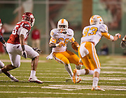 Nov 12, 2011; Fayetteville, AR, USA;  Tennessee Volunteers tailback Tauren Poole (28) carries the ball as wide receiver Zach Rogers (83) blocks and Arkansas Razorbacks linebacker Jerry Franklin (34) and Alonzo Highsmith (45) look to block during a game at Donald W. Reynolds Razorback Stadium. Arkansas defeated Tennessee 49-7. Mandatory Credit: Beth Hall-US PRESSWIRE