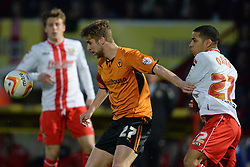 Wolves midfielder Michael Jacobs and Stevenage's defender Ryan Johnson compete for the ball  - Photo mandatory by-line: Mitchell Gunn/JMP - Tel: Mobile: 07966 386802 01/04/2014 - SPORT - FOOTBALL - Broadhall Way - Stevenage - Stevenage v Wolverhampton Wanderers - League One