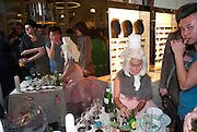 SERVING COKTAILS AND CAKES, , Wolf & Badger - pop-up store launch party. Wonder Room, Selfridges, 13 August 2010. -DO NOT ARCHIVE-© Copyright Photograph by Dafydd Jones. 248 Clapham Rd. London SW9 0PZ. Tel 0207 820 0771. www.dafjones.com.