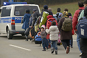 Nov. 11, 2015 - Wegscheid, Bavaria, Germany - GERMANY, Bavaria, Wegscheid; <br /> <br /> Mainly Syrian and Afghan asylum seekers crossing here from Austria into Germany at the tiny southern border village of Wegscheid.  The German authorities allow in 50 migrants per hour and escort them on buses to processing centres in Wegscheid and Passau before further distribution throughout the country<br /> ©Exclusivepix Media