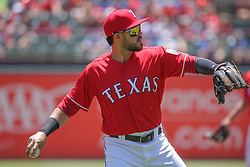 May 9, 2018 - Arlington, TX, U.S. - ARLINGTON, TX - MAY 09: Texas Rangers infielder Renato Nunez (20) throws to first base during the game between the Detroit Tigers and the Texas Rangers on May 9, 2018 at Globe Life Park in Arlington, TX. (Photo by George Walker/Icon Sportswire) (Credit Image: © George Walker/Icon SMI via ZUMA Press)