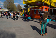Couple kissing on the Southbank walkway. The South Bank is a significant arts and entertainment district, and home to an endless list of activities for Londoners, visitors and tourists alike.
