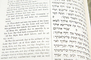 Cutout of an open Bible on white background