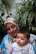 Jenin Refugee Camp, West Bank - October 23, 2010: A Palestinian woman sits with her grandchild on her lap at a home in the refugee camp in Jenin, located in the northern West Bank.