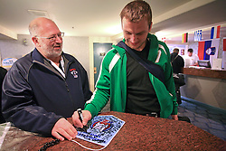 Miha Rebolj giving an autograph (left Matjaz Zargi) at Slovenian National team packing and going from Citadel Hotel to the Halifax airport, when they finished with games at IIHF WC 2008 in Halifax, on May 11, 2008, Canada. (Photo by Vid Ponikvar / Sportal Images)