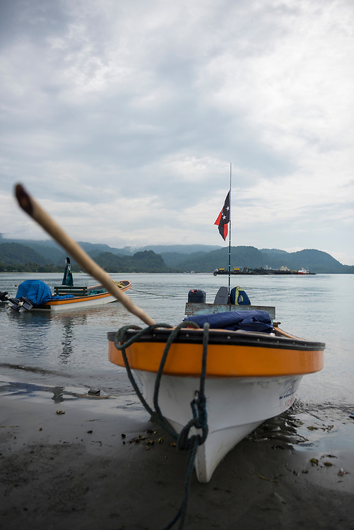 A fibreglass banana boat is beached on the sand in Vanimo, Papua New Guinea. Given the absence of a good road on this part of the country's north coast, boats like this are a common means of transportation to points along the coast.