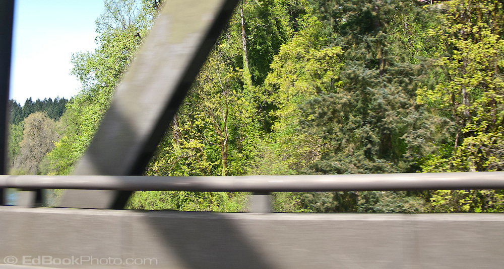 scene along a cross country trip with in a classic Mini Cooper auto - view of the Lewis River is obscured by the highway barrier on the I-5 bridge