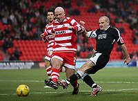 Photo: Paul Thomas.<br /> Doncaster Rovers v Swansea City. Coca Cola League 1. 17/02/2007.<br /> <br /> Andy Robinson (R) of Swansea crosses in front of James O'Connor.