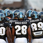 ORLANDO, FL - OCTOBER 14: Greg McCrae #30 of the UCF Knights, Shawn Burgess-Becker #28 of the UCF Knights and Anthony Roberson #89 of the UCF Knights are seen in a group huddle prior to a NCAA football game between the East Carolina Pirates and the UCF Knights at Spectrum Stadium on October 14, 2017 in Orlando, Florida. (Photo by Alex Menendez/Getty Images)