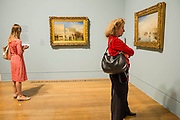 The room devoted to his works on Venice - The EY Exhibition: Late Turner – Painting Set Free - the first exhibition to survey Turner's final period of work (1835-51). From the age of 60 until his death. Highlights include: his 'radical' square oil paintings in recently restored frames - at the time of their creation, these works were his most controversial and were famously subjected to a hail of abuse in the press; Bamborough Castle c.1837 – an important work from a private collection which has only been displayed in public once in 125 years; Ancient Rome and Modern Rome c.1839 – brought together for the first time in a generation; and Turner's three final masterpieces shown in newly reconstructed frames: Mercury Sent to Admonish Aeneas, The Visit to the Tomb and The Departure of the Fleet c.1850. The show runs from 10 Sept to 25 January. Tate Britain, London, UK, 08 Sept 2014.