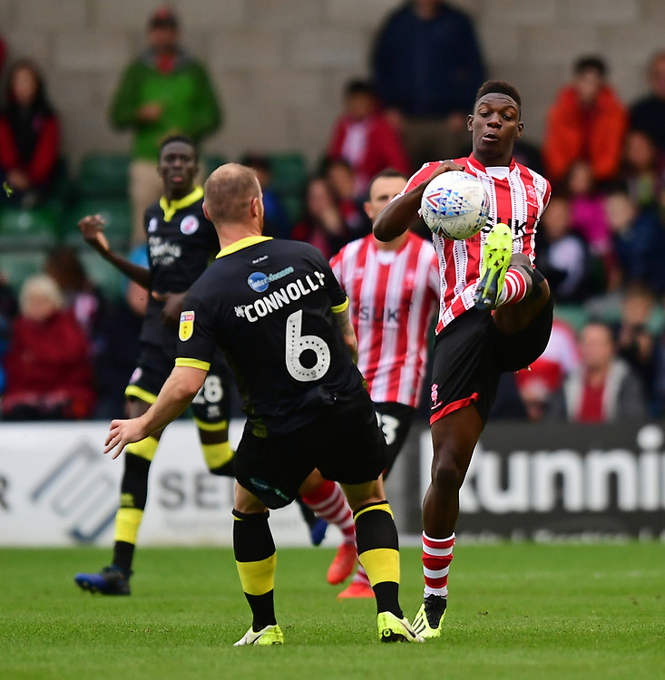 Lincoln City's Bernard Mensah vies for possession with Crawley Town's Mark Connolly<br /> <br /> Photographer Chris Vaughan/CameraSport<br /> <br /> The EFL Sky Bet League Two - Lincoln City v Crawley Town - Saturday September 8th 2018 - Sincil Bank - Lincoln<br /> <br /> World Copyright © 2018 CameraSport. All rights reserved. 43 Linden Ave. Countesthorpe. Leicester. England. LE8 5PG - Tel: +44 (0) 116 277 4147 - admin@camerasport.com - www.camerasport.com