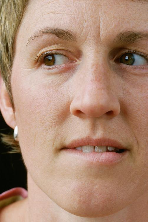 Closeup of woman biting her lip nervously