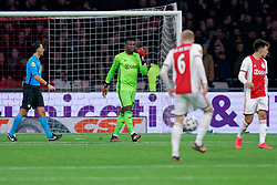André Onana #24 of Ajax and referee Serder Gozubuyuk  in action during the Dutch Eredivisie match round 25 between Ajax Amsterdam and AZ Alkmaar at the Johan Cruijff Arena on March 01, 2020 in Amsterdam, Netherlands