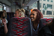 April 1, 2016; Indianapolis, Ind.; Megan Mullings and Alysha Devine ride the team's charter bus to the Women's Final Four Salute at the Indianapolis Motor Speedway.