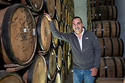 Fernando Gonzales, managing director of Siete Leguas tequila brands and grandson of the founder in the barrel room at the Casa Siete Leguas, El Centenario tequila distillery in Atotonilco de Alto, Jalisco, Mexico. The Seven Leagues tequila distillery is the oldest family owned distillery producing authentic handcrafted tequila using traditional methods.