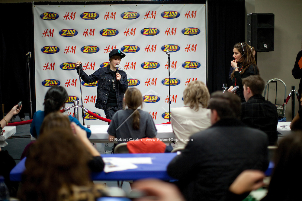 Justin Bieber does press interviews prior to performing at the 2009 Z100's Jingle Ball at Madison Square Garden in New York. ..(Photo by Robert Caplin).....
