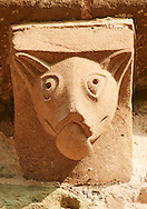Norman Romanesque exterior corbel no 21 - sculpture of an animal with a long snout and pointed ears. The Norman Romanesque Church of St Mary and St David, Kilpeck Herefordshire, England. Built around 1140 .<br /> <br /> Visit our MEDIEVAL PHOTO COLLECTIONS for more   photos  to download or buy as prints https://funkystock.photoshelter.com/gallery-collection/Medieval-Middle-Ages-Historic-Places-Arcaeological-Sites-Pictures-Images-of/C0000B5ZA54_WD0s