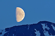 Half moon rising above Coastal Mountains<br /> near Iskut on the Cassiar Highway<br /> British Columbia<br /> Canada