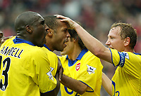 Photo. Chris Ratcliffe<br />Charlton v Arsenal. FA Premiership. 26/10/2003<br />Thierry Henry, Ray Parlour and Sol Campbell celebrate the Arsenal equaliser.