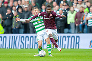 Callum McGregor(#42) of Celtic FC tackles Danny Amankwaa (#12) of Heart of Midlothian during the Betfred League Cup semi-final match between Heart of Midlothian FC and Celtic FC at the BT Murrayfield Stadium, Edinburgh, Scotland on 28 October 2018.