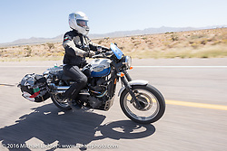 Cannonball support rider Polly Marinova of Bulgaria riding her modern Triumph during the Motorcycle Cannonball Race of the Century. Stage-13 ride from Williams, AZ to Lake Havasu CIty, AZ. USA. Friday September 23, 2016. Photography ©2016 Michael Lichter.