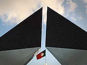 The portuguese flag stands in the entrance of a museum that pays tribute to the portuguese soldiers, next to the Tower of Belém.This photograph is part of a body of work about Lisbon, feelings, affections and loneliness. Is about a city depressed by the crisis, but even so, tolerant and cosmopolitan. This part of Lisbon, near the river Tejo (Tagus), with his deep character, where local people meets foreigners and alternative ways of life mixes with shamefaced poverty, is sublime by its peculiar light.