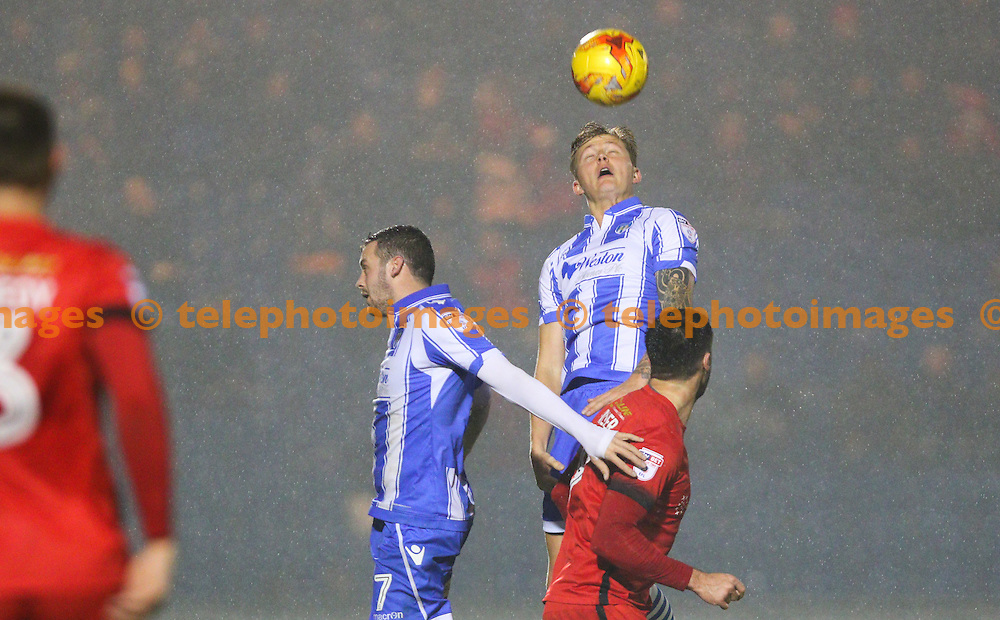 Frankie Kent of Colchester United heads the ball during the Sky Bet League 2 match between Colchester United and Leyton Orient at the Weston Homes Community Stadium in Colchester. November 12, 2016.<br /> Arron Gent / Telephoto Images<br /> +44 7967 642437