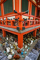 Awashima Jinja is a shrine for women, famous for its huge collection of dolls. Japanese are superstitions about dolls, many people find them mysterious or frightening, believing that they have souls or the power to influence human lives. There are a number of shrines and festivals where people dispose of their old dolls - they feel that if they just threw them in the garbage, the dolls' souls might come back to haunt them like ghosts. Awashima jinja is especially devoted to dispose of hina ningyo, which are dolls that are given to young girls on Girl's Day March 3rd. There are thousands of dolls here, as well as sculptures, figurines, carvings, and statues. You'll find tanuki, maneki neko, daruma, frogs and many more.