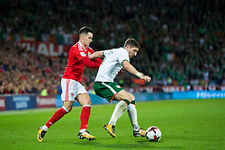 CARDIFF, WALES - Monday, October 9, 2017: Wales' Tom Lawrence and Republic of Ireland's Stephen Ward during the 2018 FIFA World Cup Qualifying Group D match between Wales and Republic of Ireland at the Cardiff City Stadium. (Pic by Paul Greenwood/Propaganda)