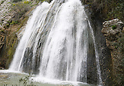 Israel, Upper Galilee, Iyyon River Nature reserve. The Mill waterfall and chalk cliffs