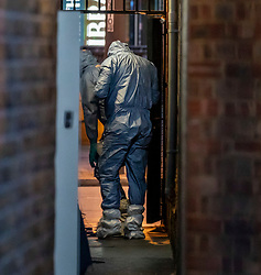 © Licensed to London News Pictures. 02/02/2020. London, UK. Forensics search an alley way off Streatham High Road as Shoppers are lead to safety. Terror attack in Streatham South London as Police shoot dead a knife-wielding suspect in a suicide vest after two people were stabbed. Photo credit: Alex Lentati/LNP