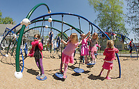 Holy Trinity Pre K and Kindergarten students enjoy active play times during recess in their playground area off Messer Street Thursday afternoon.  (Karen Bobotas/for the Laconia Daily Sun)