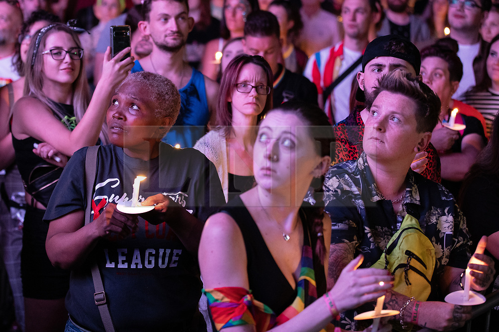 © Licensed to London News Pictures . 26/08/2019. Manchester, UK. A candlelit vigil , organised by the George House Trust , in memory of the victims of HIV and AIDS , takes place in Sackville Gardens in Manchester's Gay Village , at the close of 2019's Manchester Pride . Photo credit: Joel Goodman/LNP