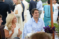 ADAM BIDWELL and KATHERINE JENKINS at the 2013 Cartier Queens Cup Polo at Guards Polo Club, Berkshire on 16th June 2013.